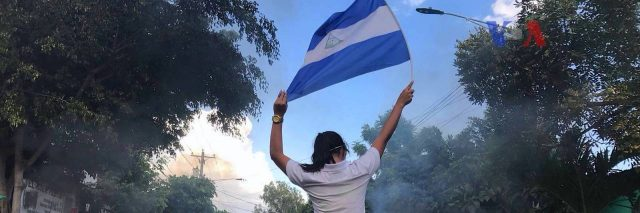 violence in Nicaragua, girl waving flag