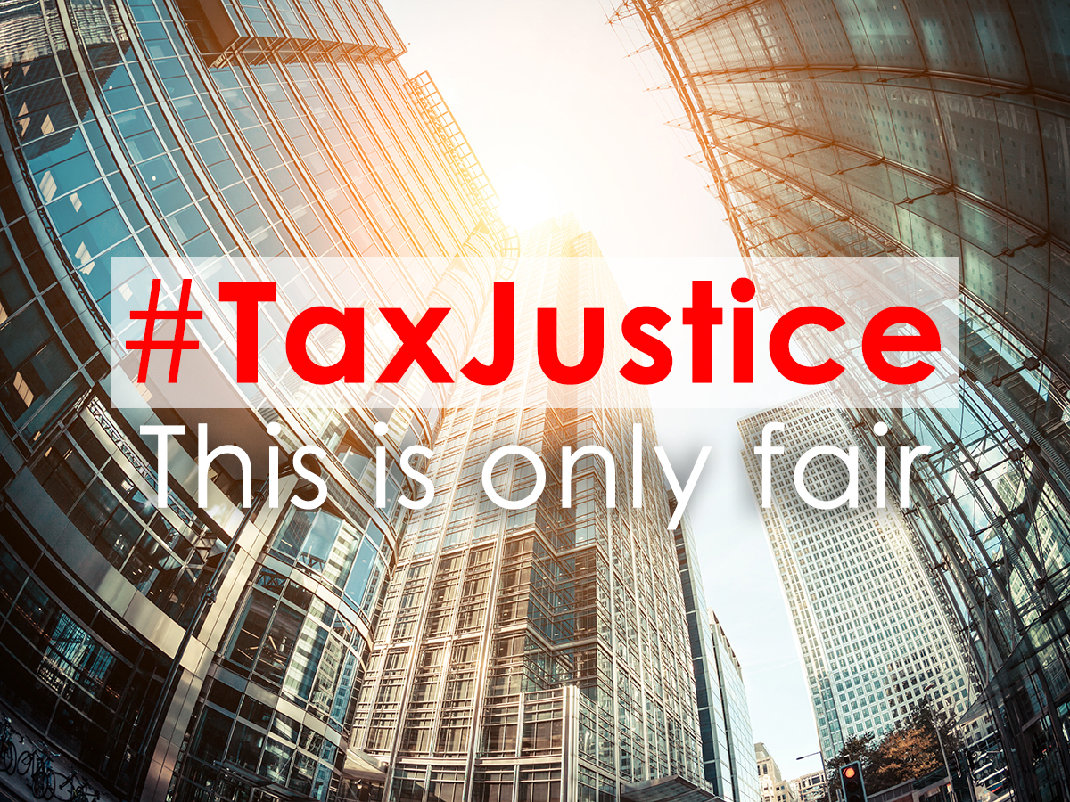 #TAX JUSTICE in front of large company buildings