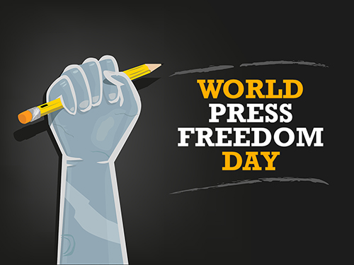Hand clutching pencil in the air, World press Freedom Day