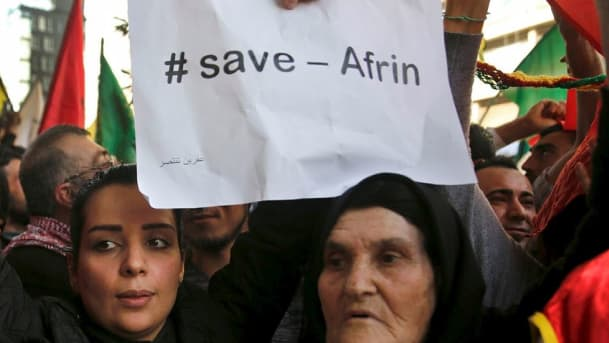 Kurds in road with #save Afrin poster
