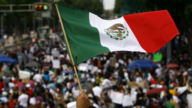 Mexican flag and election protesters in the street
