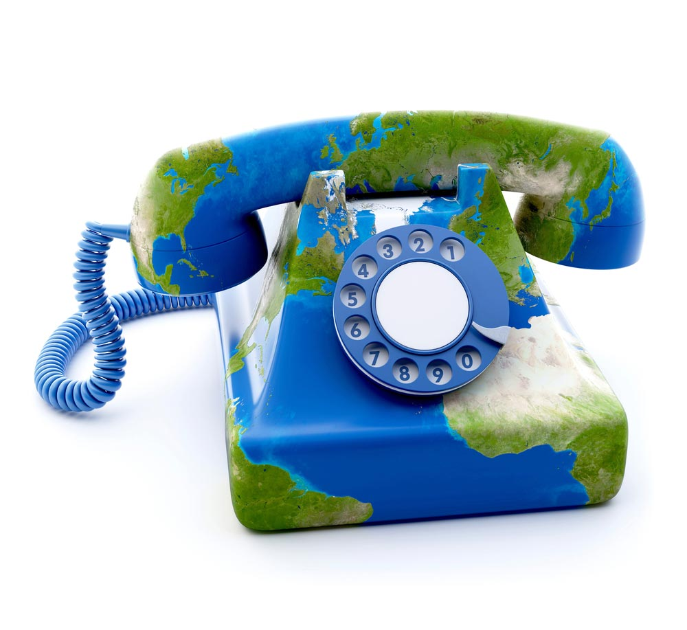 Old fashioned phone with world map on it