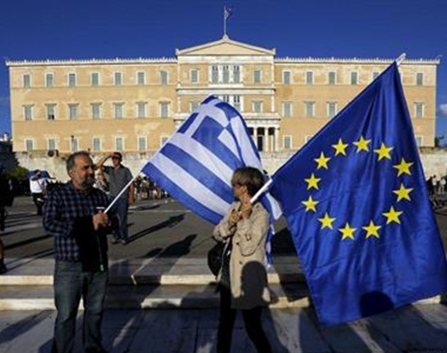 People holding Greek and EU flag