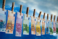 Euro notes hanging on a washing line