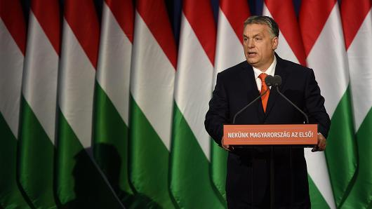 Viktor Orban in front of lots of Hungarian flags