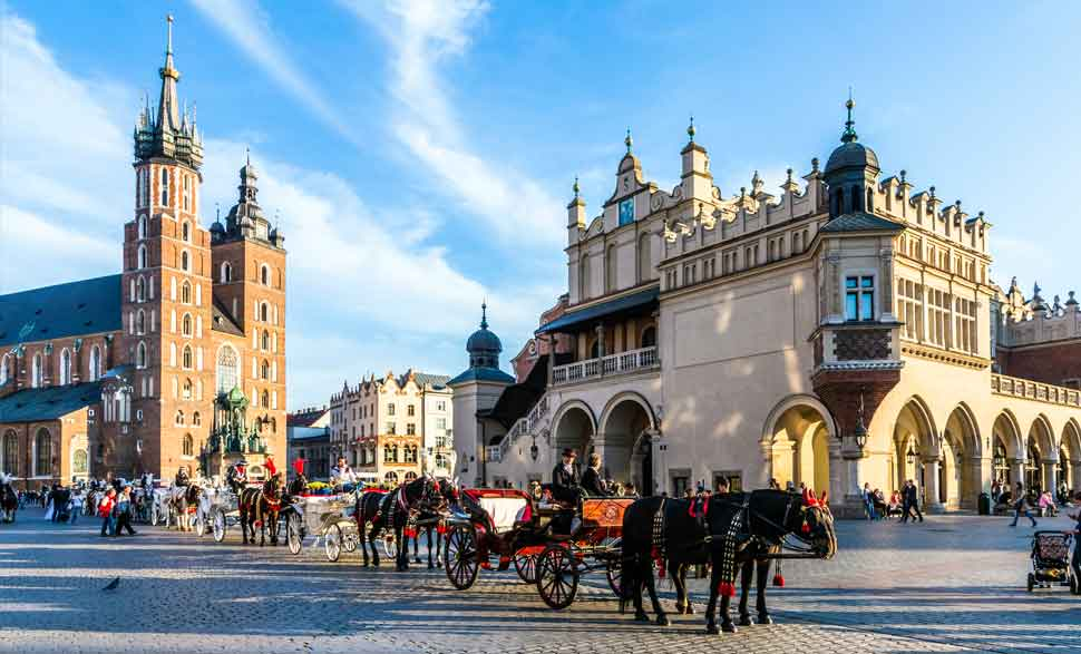 Square and horse drawn carriages in Krakow, Poland