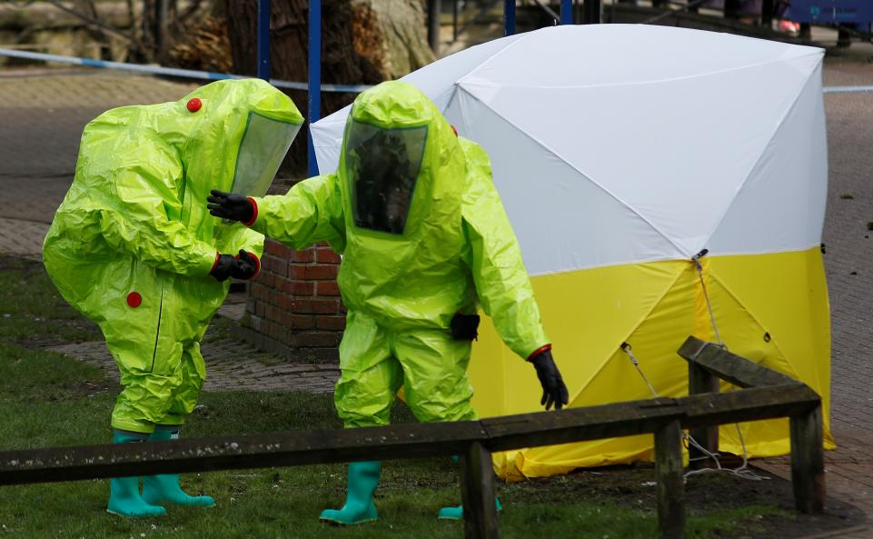 2 men in yellow chemical suits