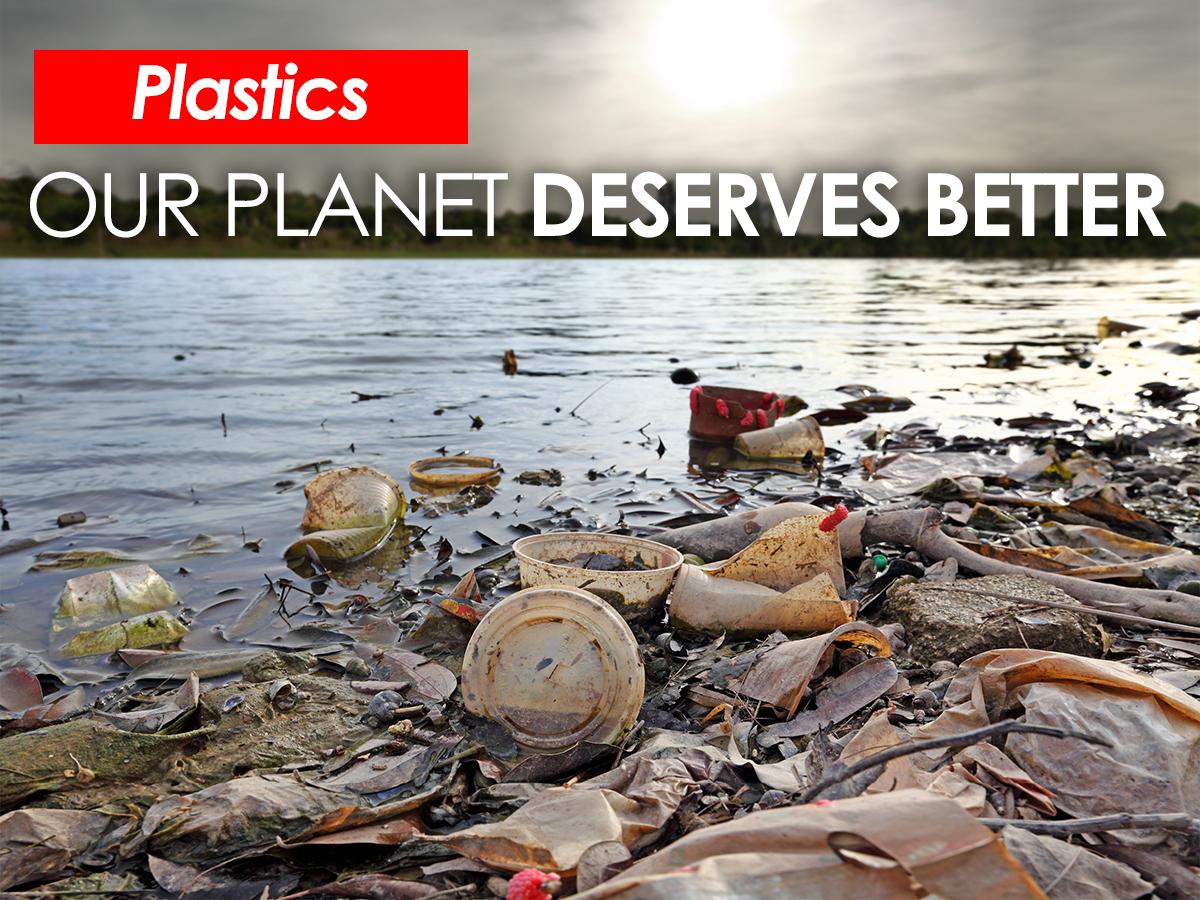 Word Plastics and plastic litter on beach