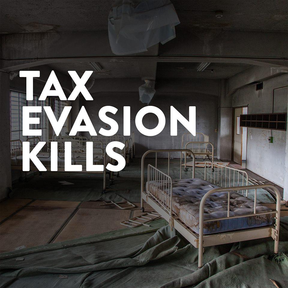 Derelict hospital ward with banner tax evasion kills