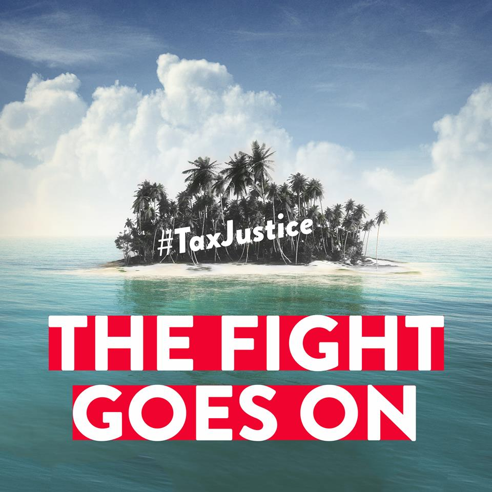 tax justice - fight goes on text over island in sea