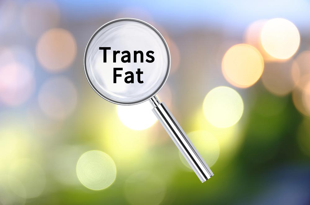 Magnifying glass with Trans Fat through it