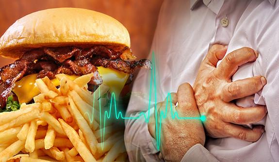 greasy hamburger and person having a heart attack