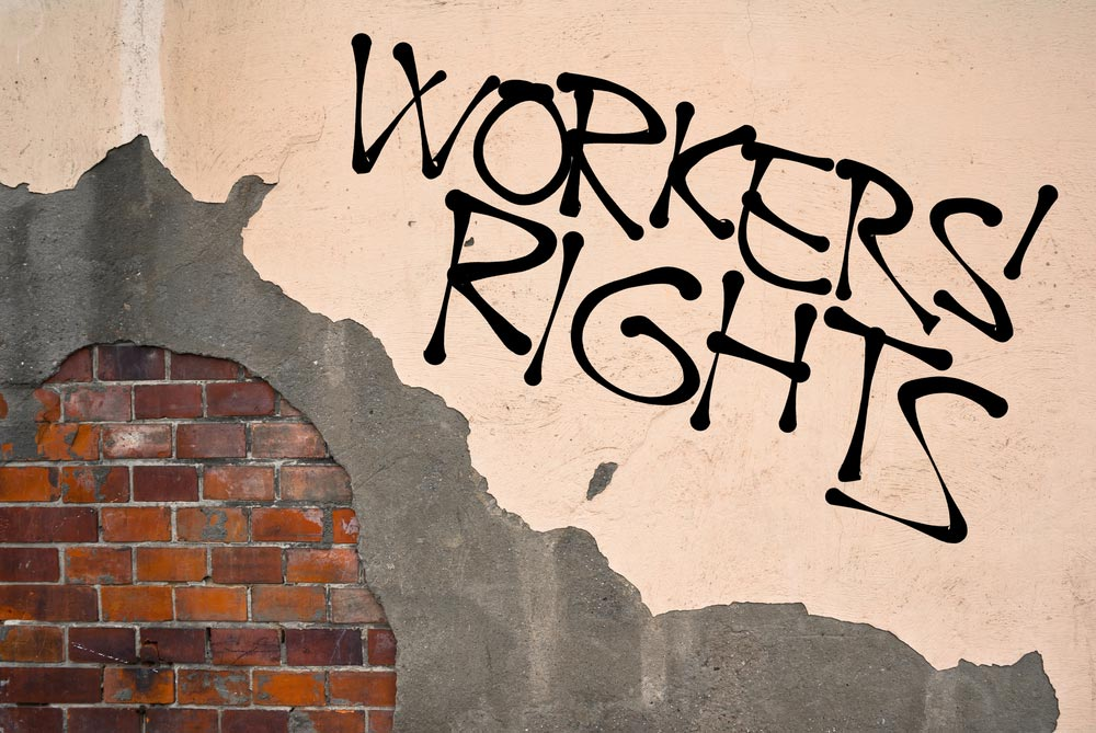Wall and big letters WORKERS' RIGHTS
